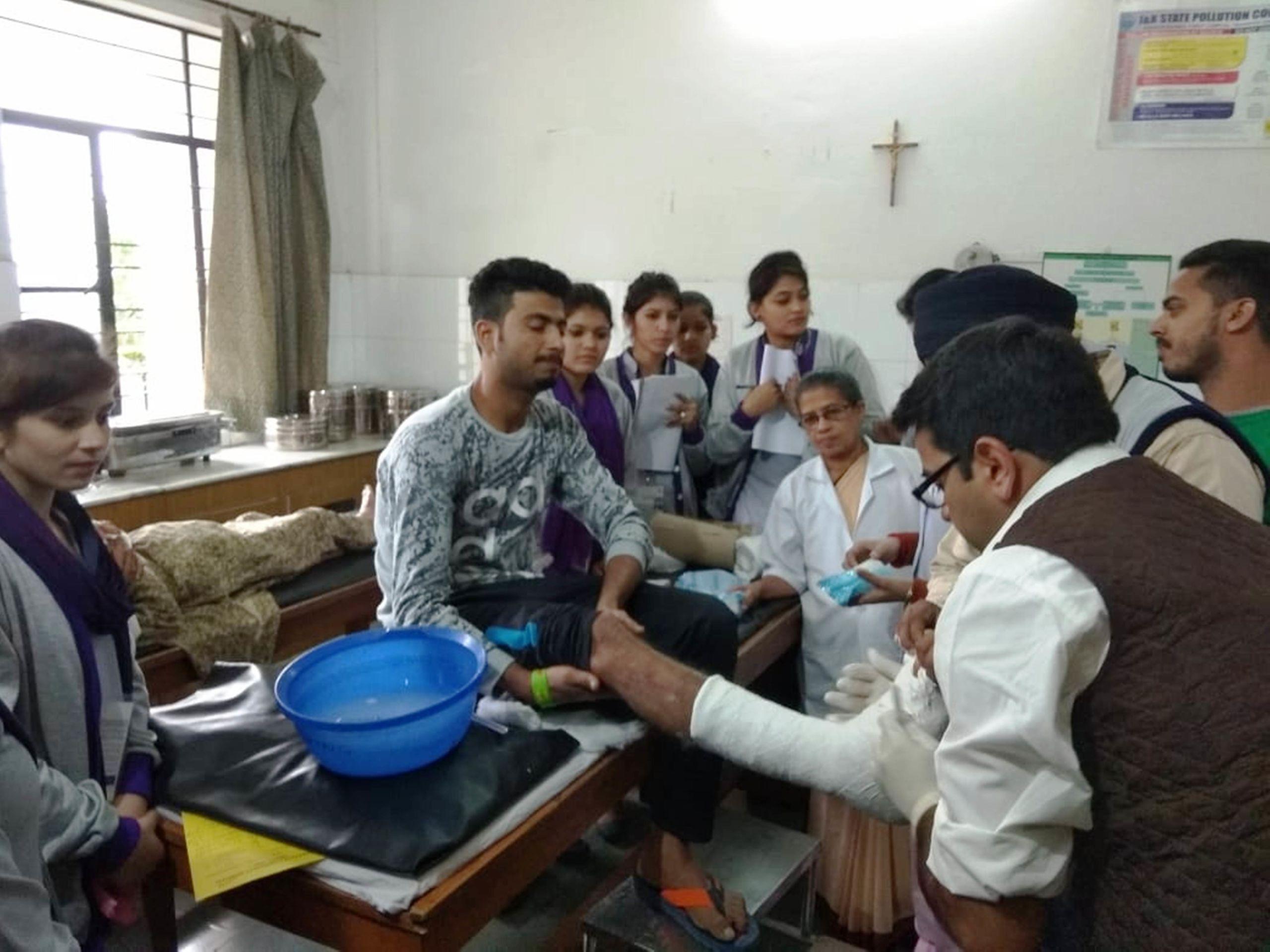St. Joseph's Community Hospital medicos treat a patient.